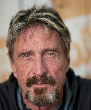 Antivirus pioneer John McAfee poses for a photograph in Montreal, Friday, August 24, 2013.(AP Photo/The Canadian Press, Graham Hughes)